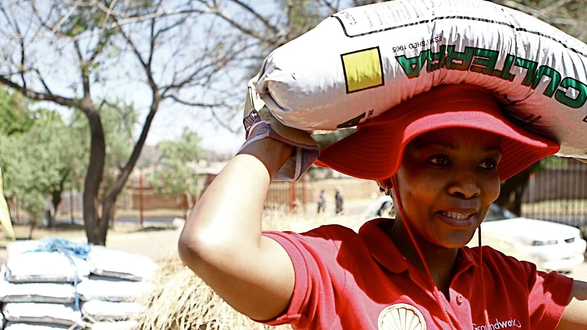 Groundworx Volunteer carrying sack on her head