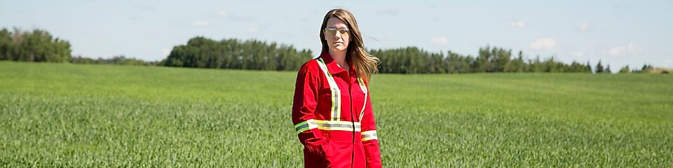 An employee stands in a field near a Quest C02 injection well northeast of Edmonton, Alberta in Canada